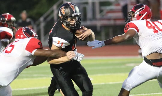 Anderson quarterback David Thompson runs the ball  during the Redskins football game against Mt. Healthy, Thursday, Aug. 23,2018.