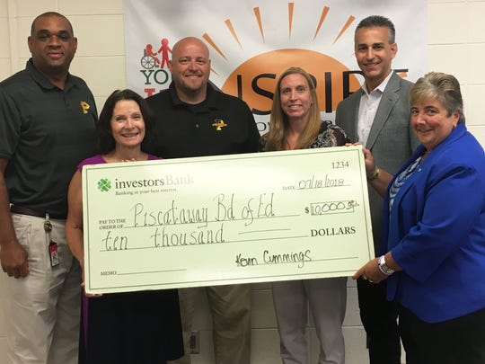Left to right: PHS Principal Jason Lester, Piscataway Superintendent Teresa Rafferty, Athletic Director Robert Harmer, Assistant Athletic Director Julia Schick, Business Administrator David Oliveira, and Investor's Bank Assistant Vice President/Branch Manager Pat Grazioso.