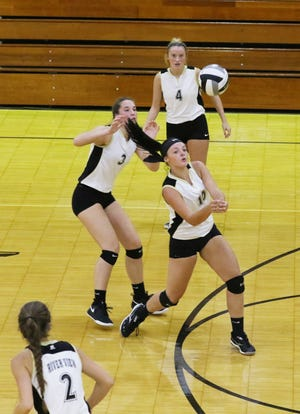 River View's Alyssa Thomas hits the ball against Cambridge.