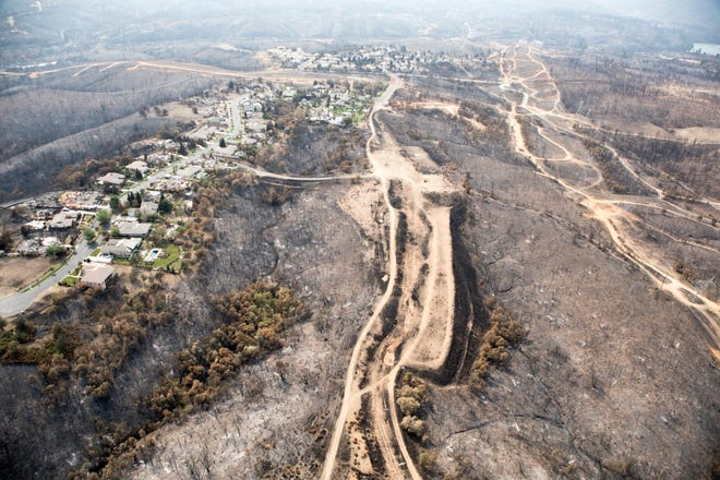 Aerial of Land Park and Stanford Hills subdivision areas following the Carr fire in Shasta Co., Calif., Tuesday, August 21, 2018.