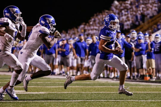 Detroit Catholic Central running back Keegan Koehler runs against Walled Lake Western during the second half of a Prep Kickoff Classic game at Wayne State University's Tom Adams Field in Detroit, Thursday, August 23, 2018.
