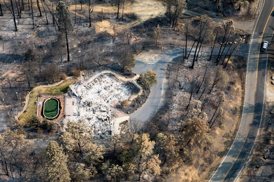 A view from above shows where the Carr Fire burned a home in the Shasta area during the Carr Fire.