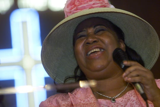 Aretha Franklin belts out a gospel song during a tribute to her father the late Rev. C.L Franklin at the New Bethel Baptist Church in Detroit on Sunday, July 29, 2001.