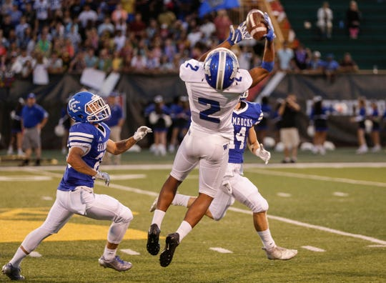 Walled Lake Western receiver Abdur-Rahmaan Yaseen makes a catch during the first half of a Prep Kickoff Classic game against Detroit Catholic Central at Wayne State University's Tom Adams Field in Detroit, Thursday, August 23, 2018.