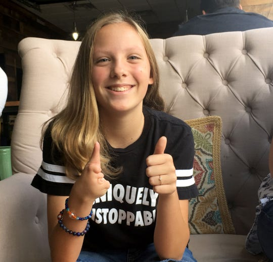 Ryan Stapelman, 11, gives a thumbs up in Royal Oak on Aug. 21, 2018. Ryan has monodactyly, which means she has one finger on her right hand.