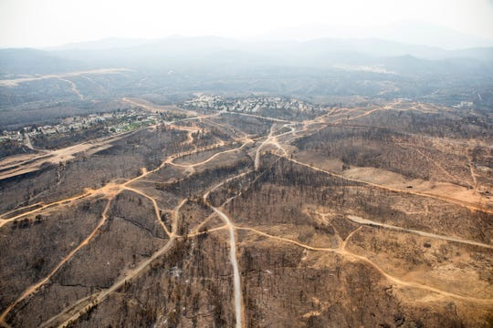 Aerial of Land Park and Stanford Hills subdivision areas following the Carr Fire on Tuesday, August 21, 2018.