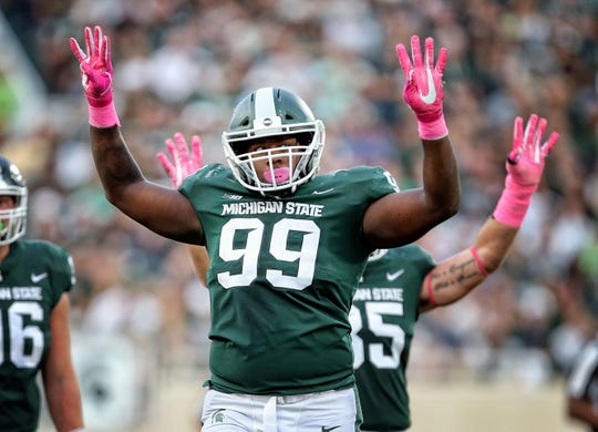 Michigan State defensive tackle Raequan Williams reacts to a play during the first quarter against Indiana at Spartan Stadium on Oct. 21, 2017 in East Lansing.
