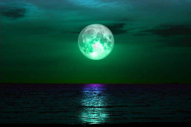 Stock image of full sturgeon moon on night sky.