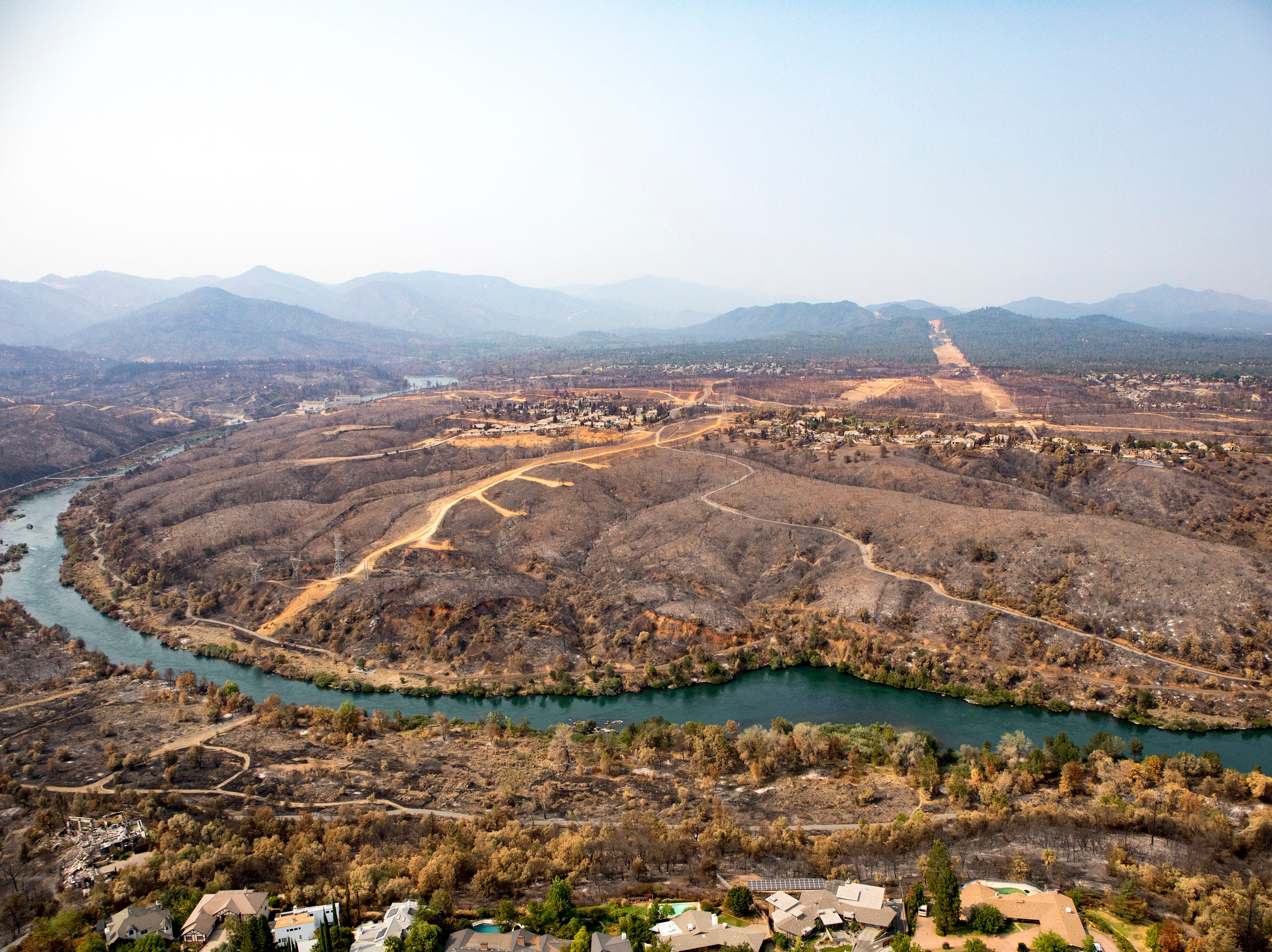 Aerial of Land Park and Stanford Hills subdivision areas following the Carr Fire in Redding.