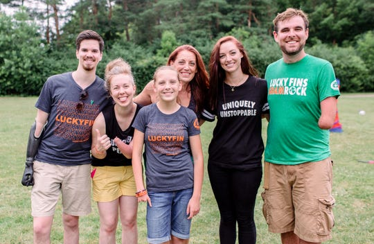 From  left, Trace Wilson, Alexis Hillyard, Ryan Stapelman, Molly Stapelman, Ashley Sherman and Tony Memmel. Molly Stapelman, founder of The Lucky Fin Project, and her daughter, Ryan, pose for a photo with some of the Lucky Fin Project Ambassadors at the 2018 annual Lucky Fin Project Weekend in Troy.