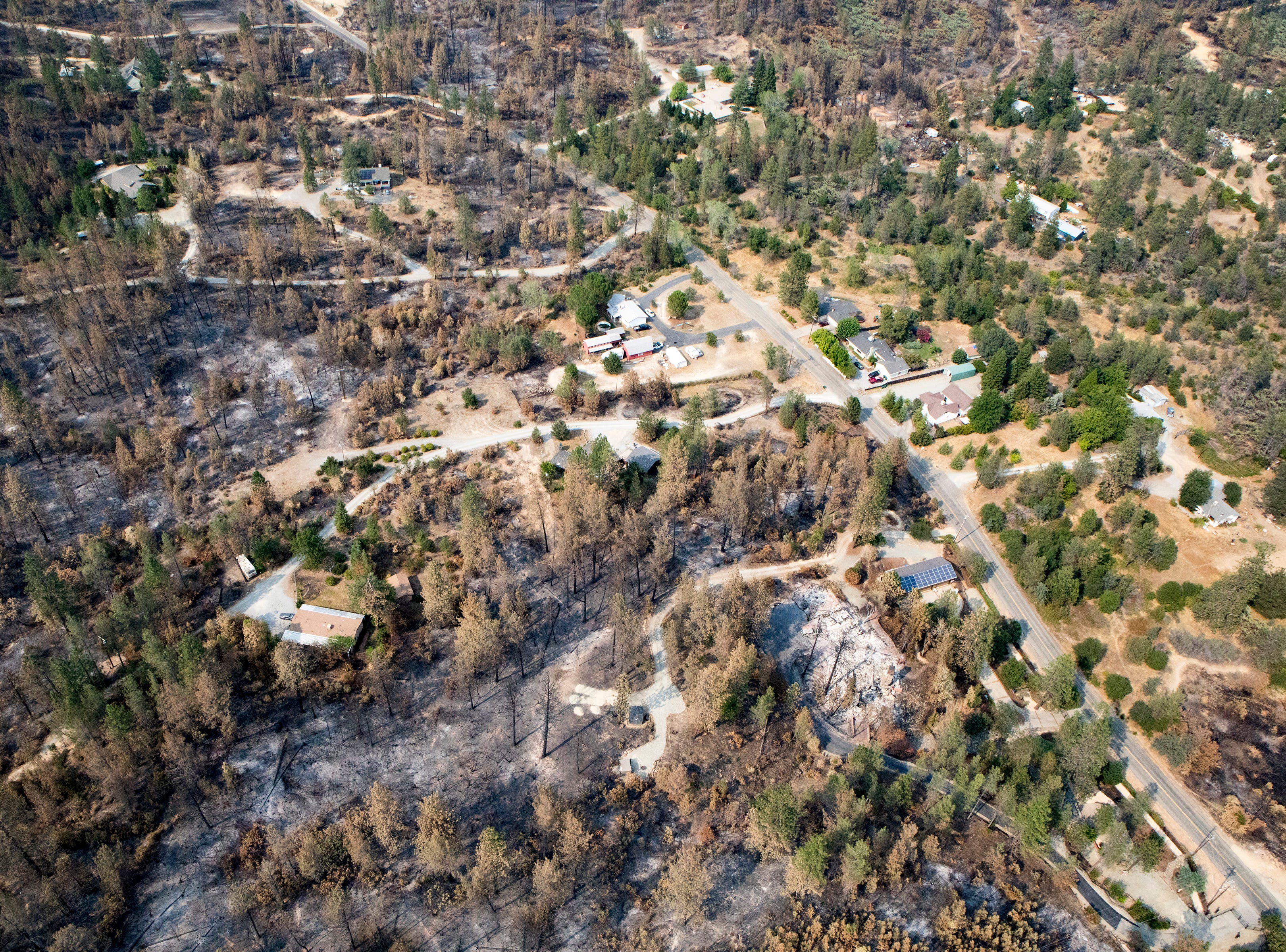 Aerial of following the Carr fire in Shasta Co., Calif., Tuesday, August 21, 2018.