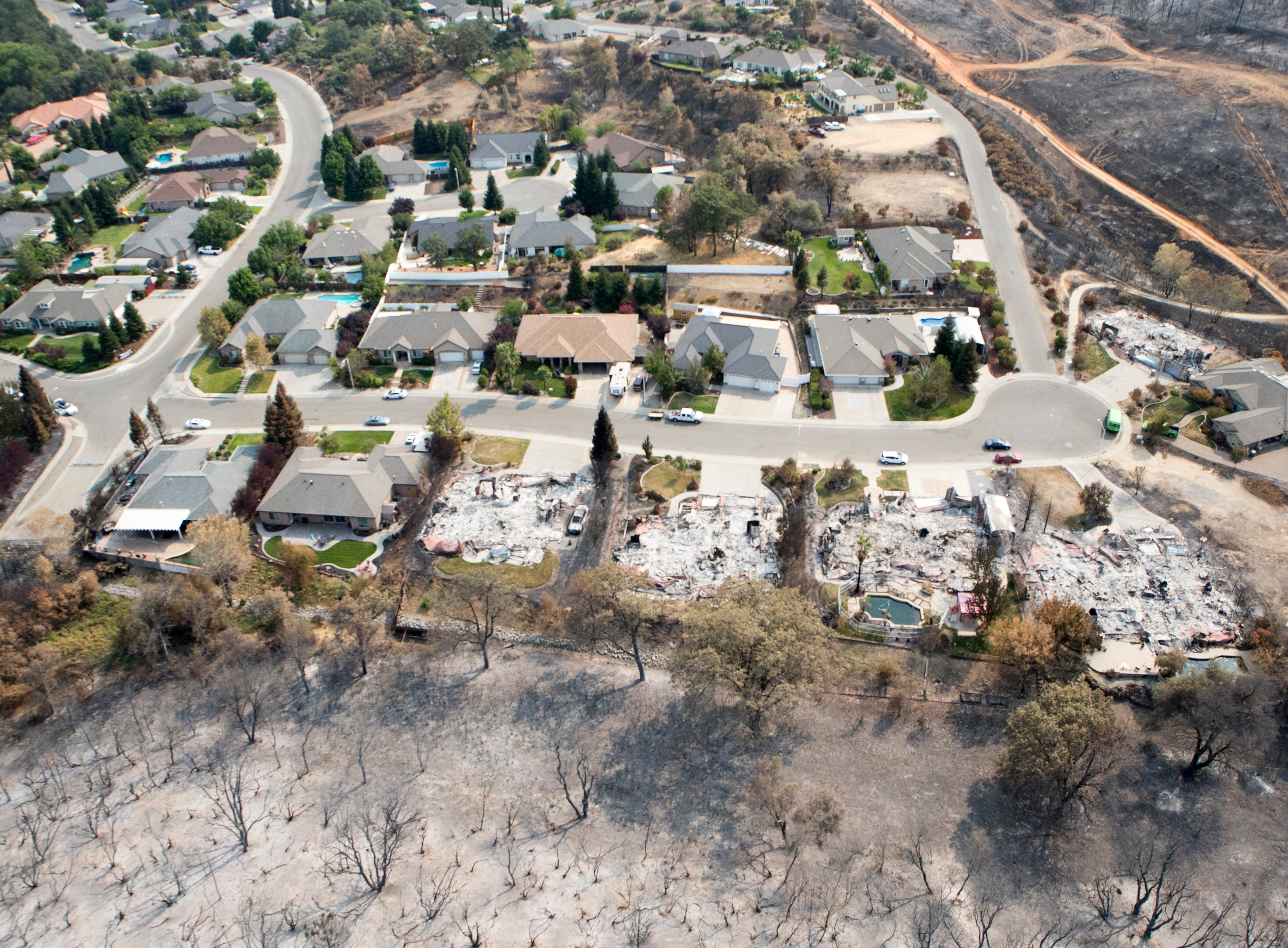 The western edge of the Mary Lake subdivision shows the Carr Fire's destruction.