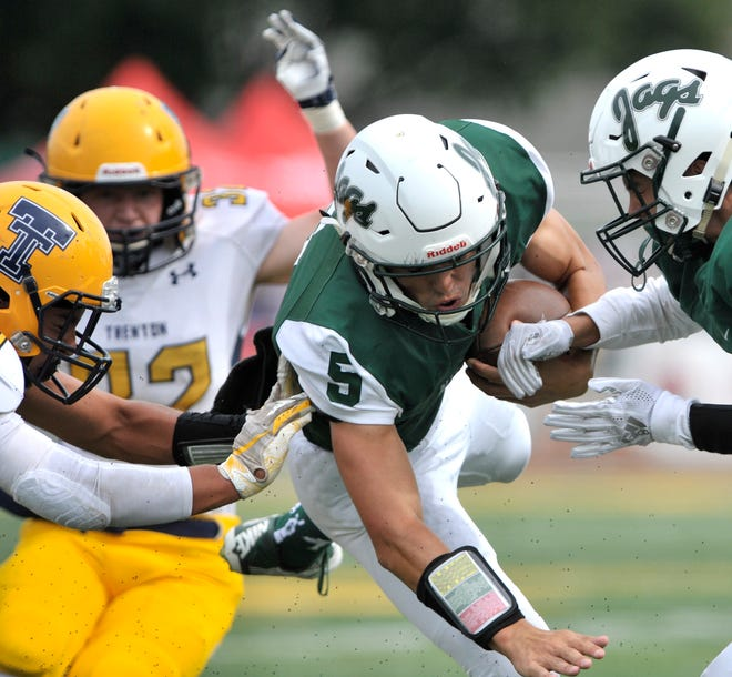 Allen Park's Nick Arnoldy is upended by the Trenton defense on a first-and-goal carry near the end of the first quarter on Friday.