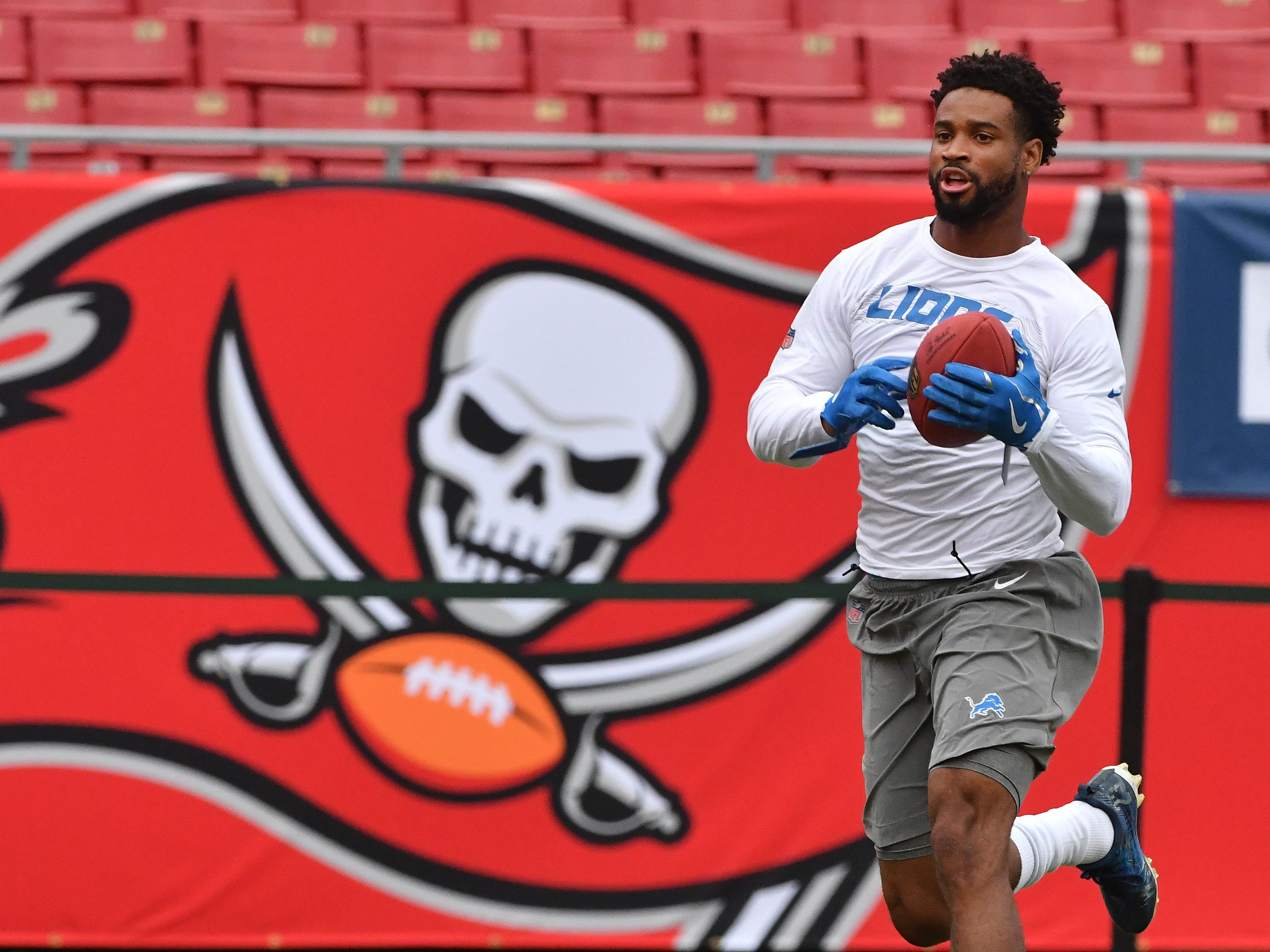 Lions corner back Darius Slay jogs on the field during warmups before Detroit takes on the Tampa Bay Buccaneers.