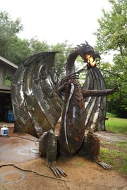 The 12-foot-tall, fire-breathing metal dragon is made of about 3,000 hand-cut, recycled metal pieces and weighs about 2,000 pounds.