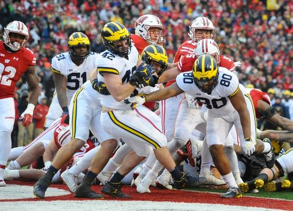 """Michigan fullback Ben Mason, seen crossing the goal line in a game last season, said he's willing to step in on defense """"if I'm needed."""""""