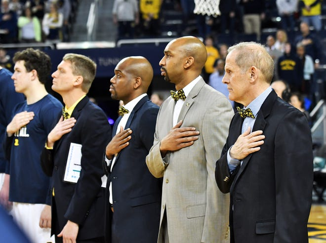 Michigan basketball coach John Beilein, from right, and assistants Saddi Washington, DeAndre Haynes and Luke Yaklich all received raises this summer following one of the most successful seasons in program history that included an appearance in the national title game.