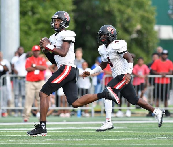 Oak Park quarterback Dwan Mathis, running the ball in the fourth quarter Thursday, says he remains firmly committed to Ohio State.