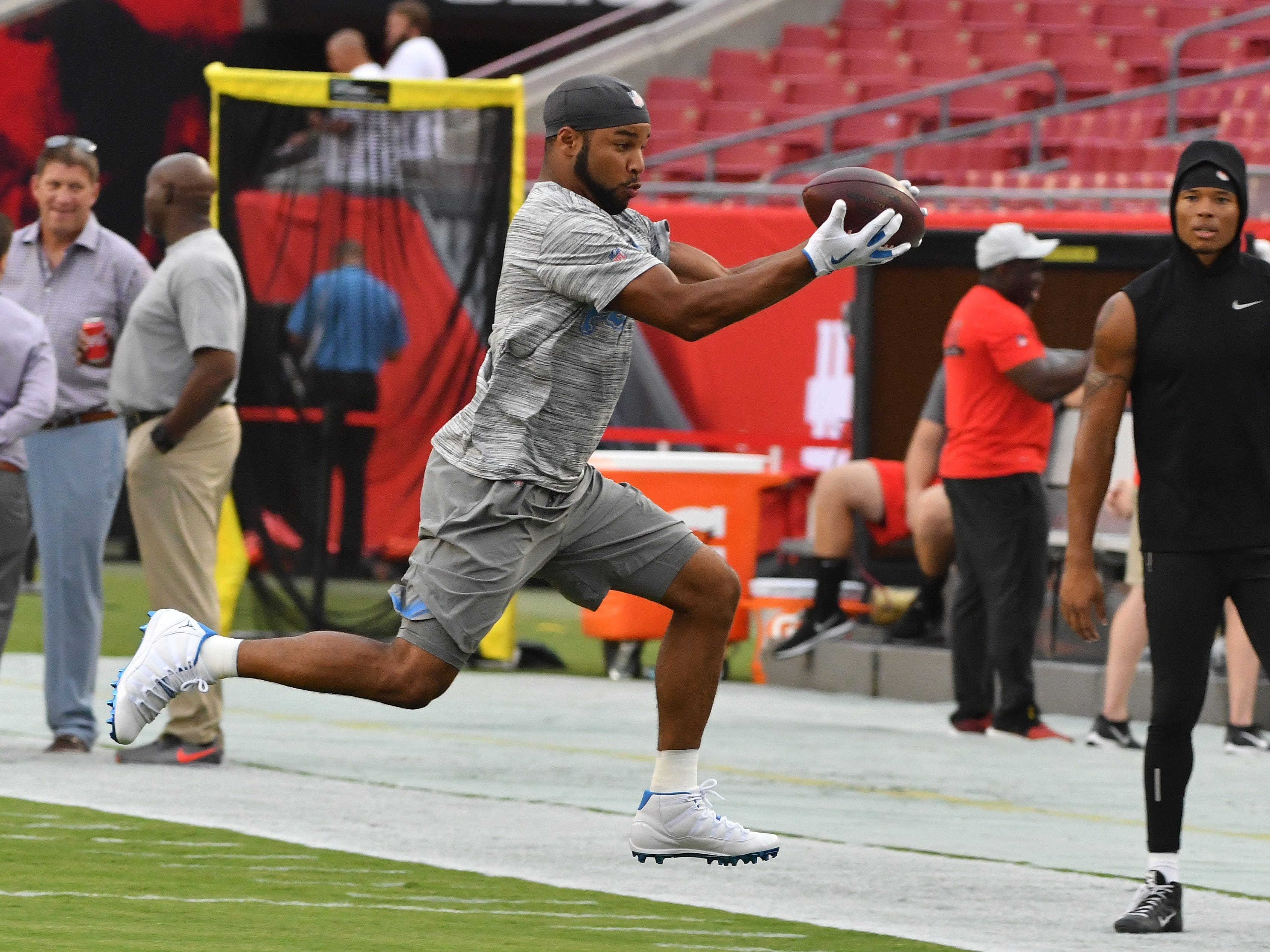 Lions wide receiver Golden Tate gets some air making a reception along the sidelines during warmups.