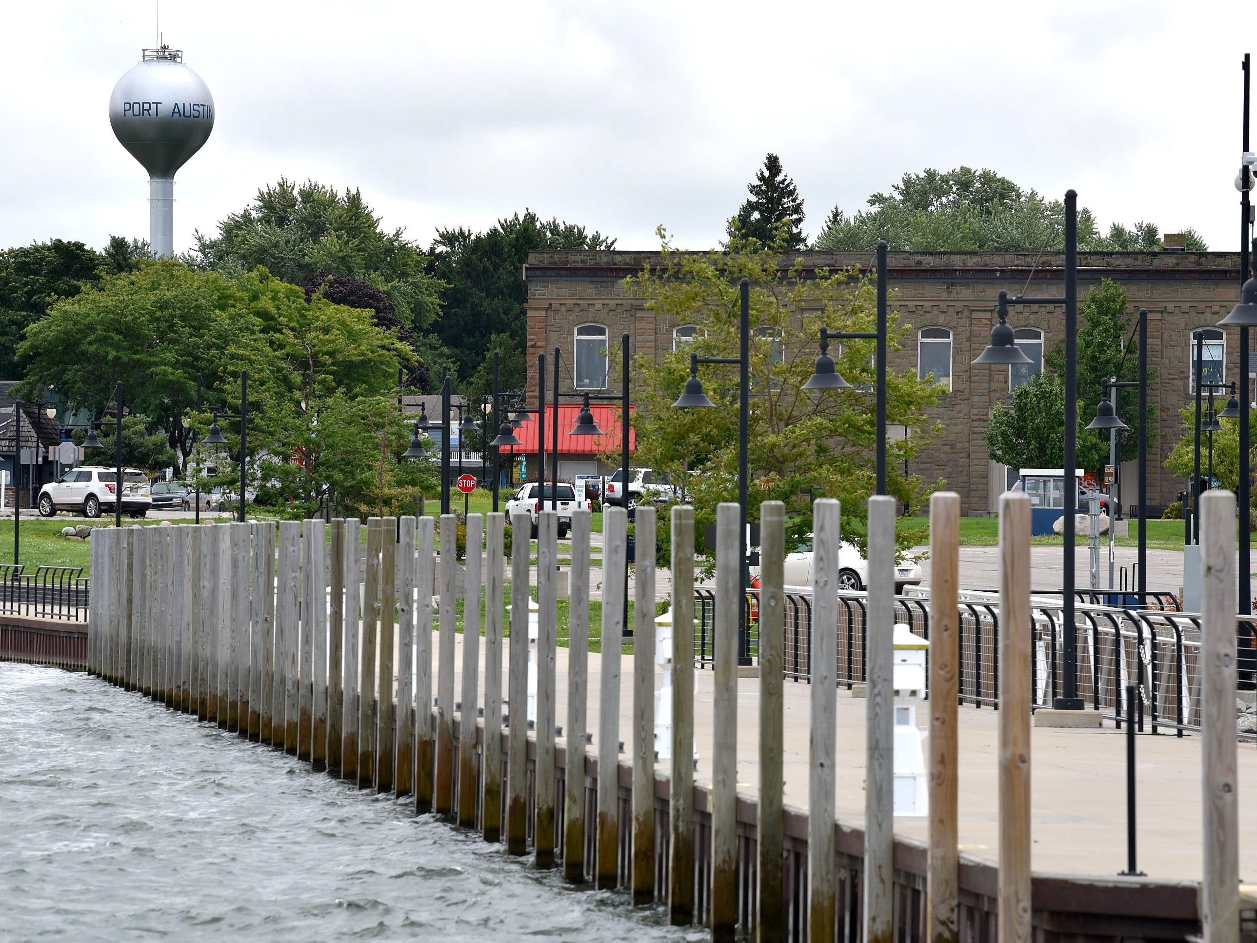 These are mooring poles along a walkway at the Port Austin State Harbor.