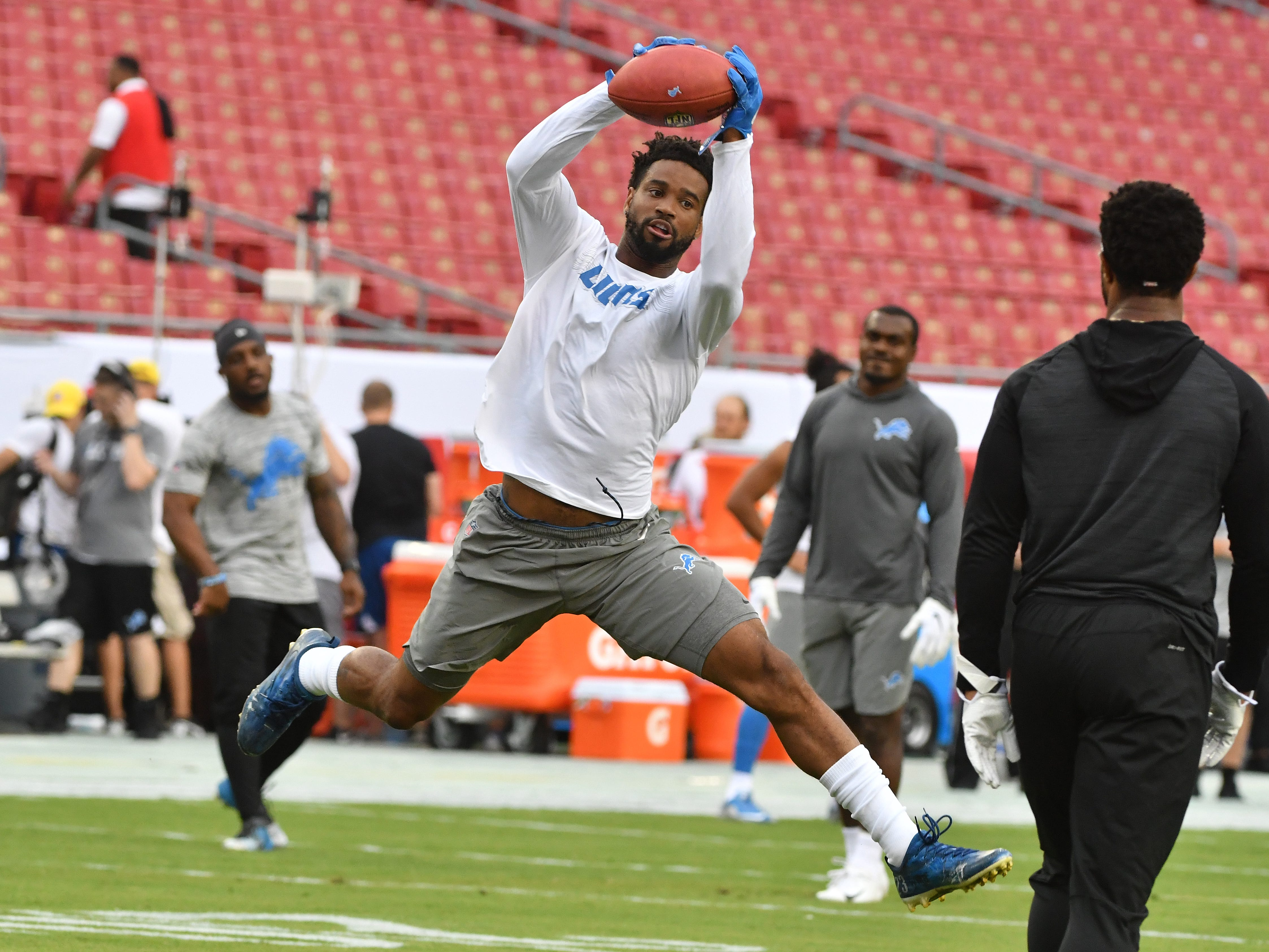 Lions corner back Darius Slay stretches out for a reception during drills.