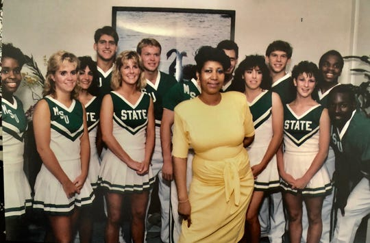 Aretha Franklin poses with the Michigan State Spartans cheerleading squad, which she hired to celebrate son Teddy White's graduation (in Communications) at a party at her Bloomfield house in June 1986.