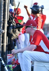 Reds' Ryan Huizdos watches while the Reds play the Pirates in a Grosse Pointe Woods-Shores Harper Woods Little League game at Kerby Park Field in Grosse Pointe Farms, Mich. on July 19, 2018. The Reds play with a yellow baseball because one of the players, Ryan Huizdos, has albinism, a visual impairment, and the yellow ball is easier to see.