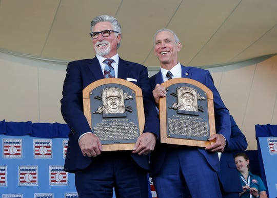 Jack Morris and Alan Trammell pose with their Hall of Fame plaques on July 29.