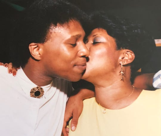 Aretha and son Teddy White, then 22, exchange a kiss at the party celebrating his Michigan State graduation in 1986.