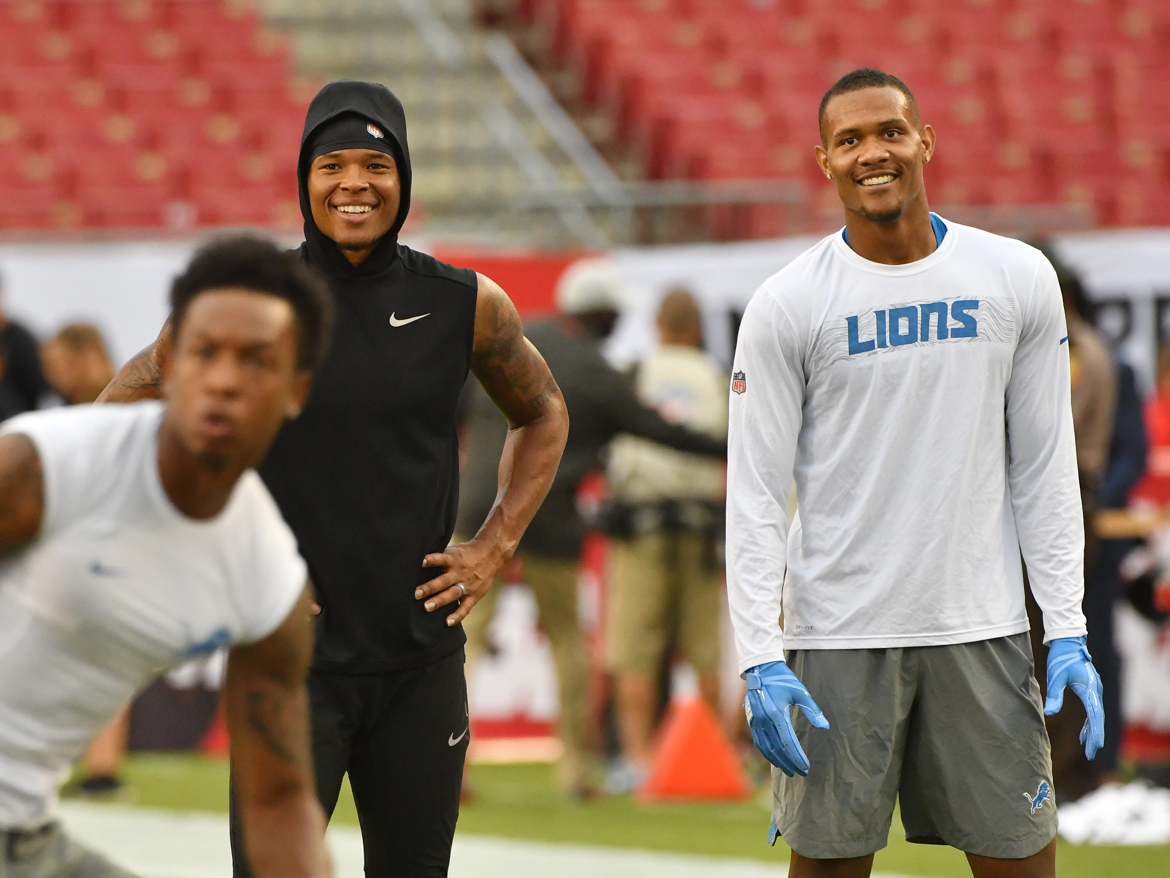 Lions wide receivers Marvin Jones Jr. and Kenny Golladay share a laugh during warmups.
