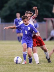 Winnebago Lutheran Academy's Kaleb Schroeder blocks New Holstein's Dylen Ecker during an Aug. 23 game in Fond du Lac.