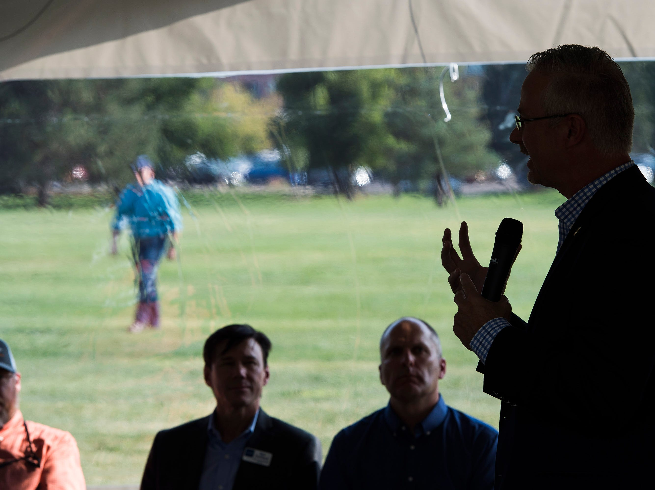 "Fort Collins city manager Darin Atteberry, right, speaks during a ""groundbreaking"" ceremony for the Poudre River Whitewater Park on Thursday, Aug. 23, 2018, next to the Cache La Poudre River in Old Fort Collins Heritage Park in Fort Collins, Colo."