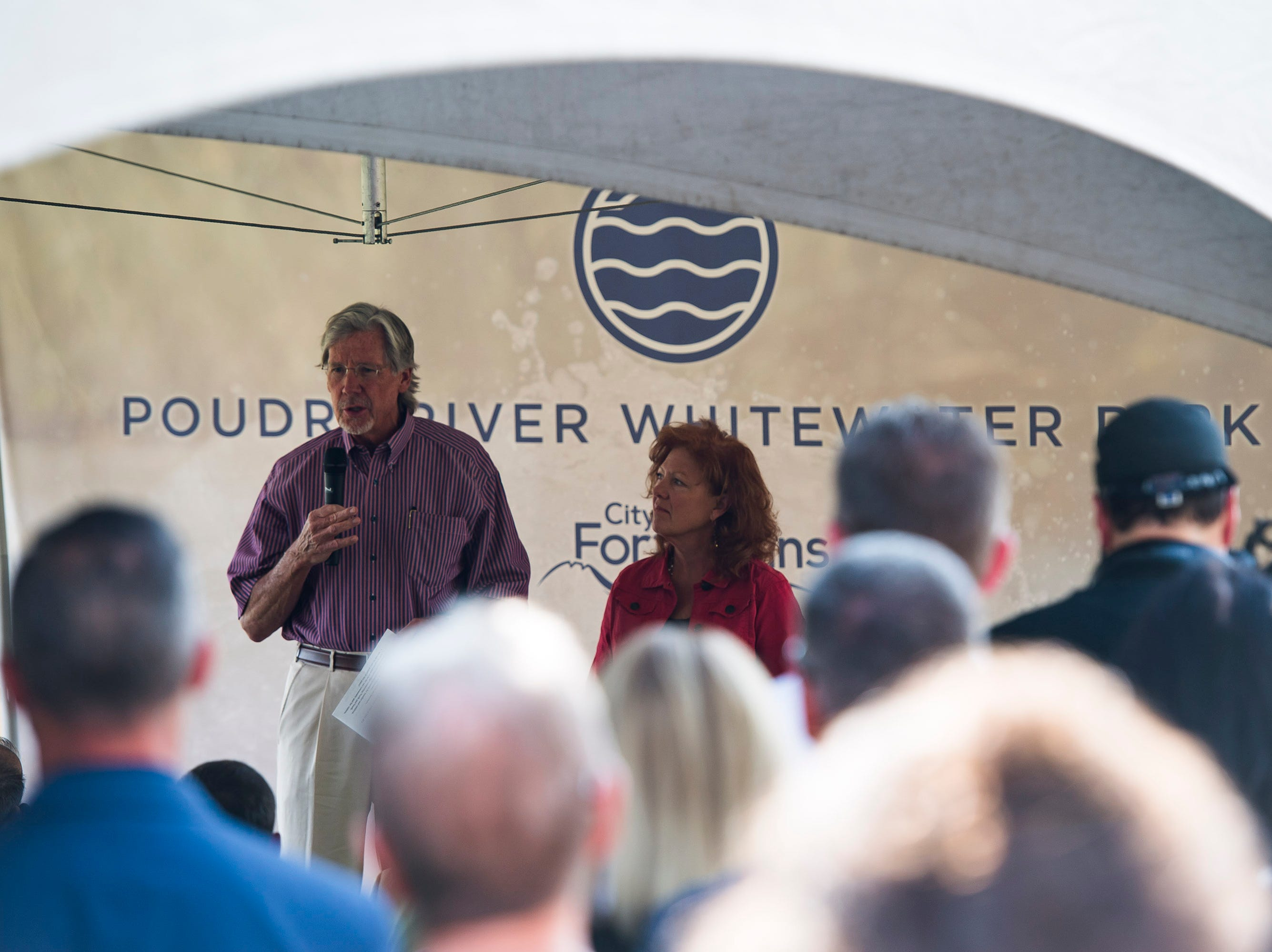 "Jack  and Ginger Graham speak during a ""groundbreaking"" ceremony for the Poudre River Whitewater Park on Thursday, Aug. 23, 2018, next to the Cache La Poudre River in Old Fort Collins Heritage Park in Fort Collins, Colo."