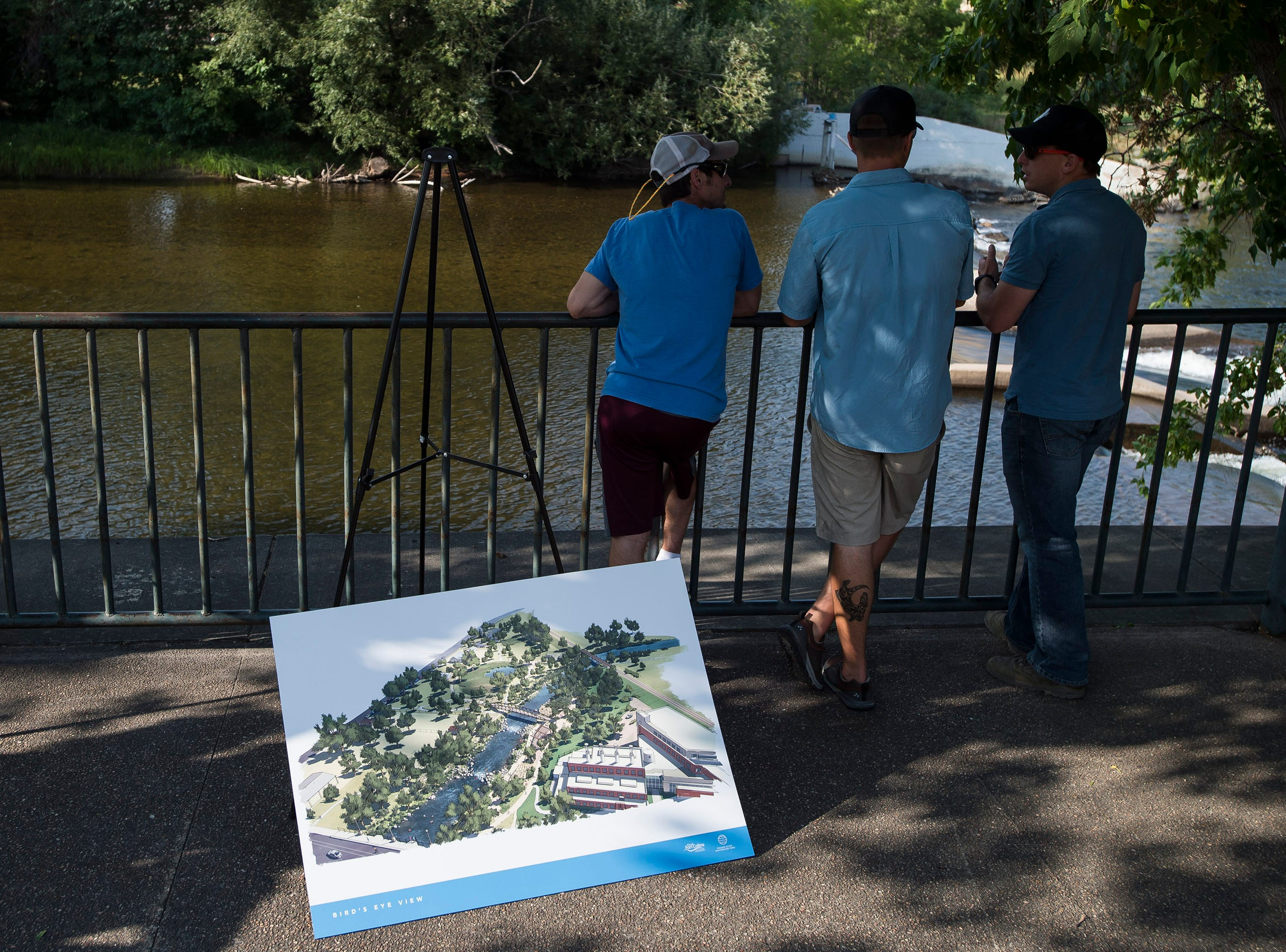 "Guests look over the future site of the Poudre River Whitewater Park after a ""groundbreaking"" ceremony on Thursday, Aug. 23, 2018, next to the Cache La Poudre River in Fort Collins, Colo."
