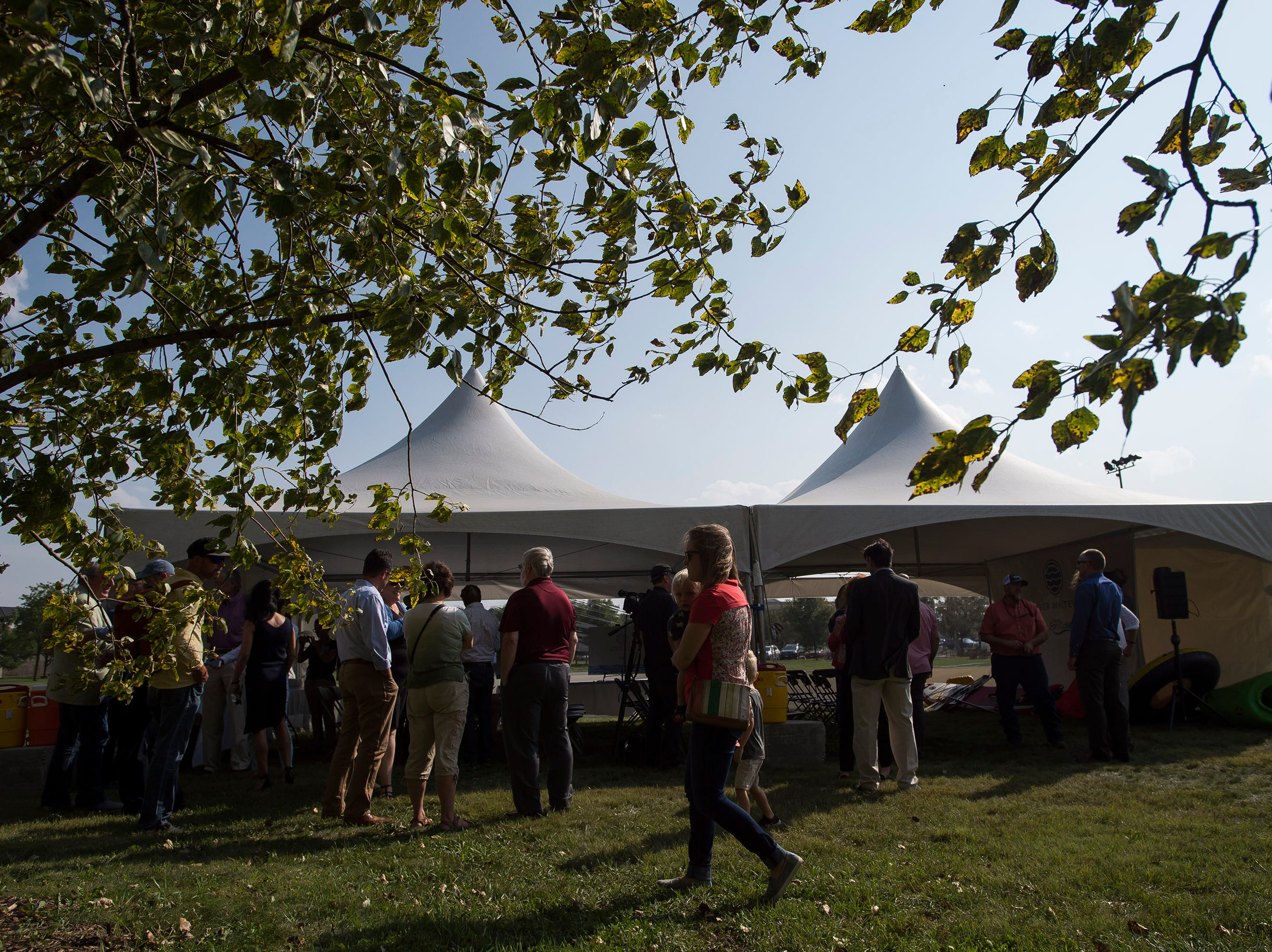 "A crowd assembles at an event tent before a ""groundbreaking"" ceremony for the Poudre River Whitewater Park on Thursday, Aug. 23, 2018, in Old Fort Collins Heritage Park in Fort Collins, Colo."