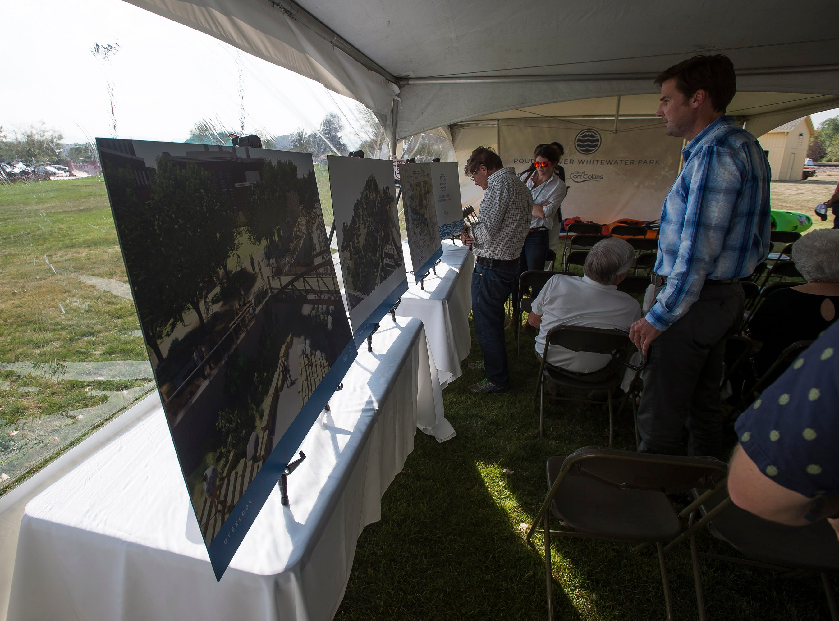 "Guests look at renderings of the Poudre River Whitewater Park before a ""groundbreaking"" ceremony on Thursday, Aug. 23, 2018, next to the Cache La Poudre River in Old Fort Collins Heritage Park in Fort Collins, Colo."