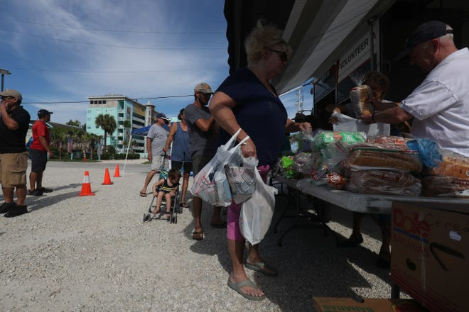 The Harry Chapin Food Bank opened a mobile food pantry on Fort Myers Beach Friday, Sept. 24, 2018, to help those affected by the red tide outbreak. Fort Myers Beach restaurants and hotels, along with other businesses, are taking a major financial hit.