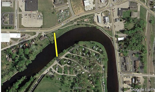 The yellow line shows the location of the planned pedestrian bridge across the Oconto River. Construction is planned for next year.
