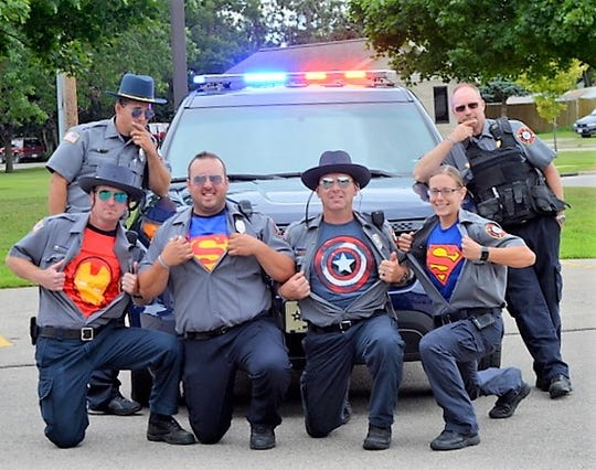 Members of the Oconto Fire Department are seen during the Lip Sync Challenge video, taped and posted this month.