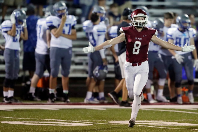 De Pere's Max Minor (8) celebrates after he kicked the game-winning field goal against Green Bay Southwest in an FRCC football game Thursday at De Pere High School.