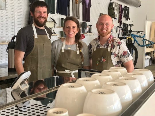 Mountain Goat co-owners, Ryan and Chrissy McCrary (left) and barista, Jon Stegenga.