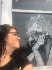 Rachel Kaiser was recently reunited with a portrait she painted of her late father one day after it was stolen from her front yard.