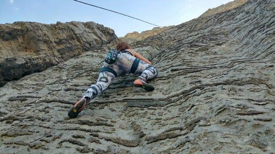 Sarah dettmer climbs a route in the Blackleaf near Choteau.