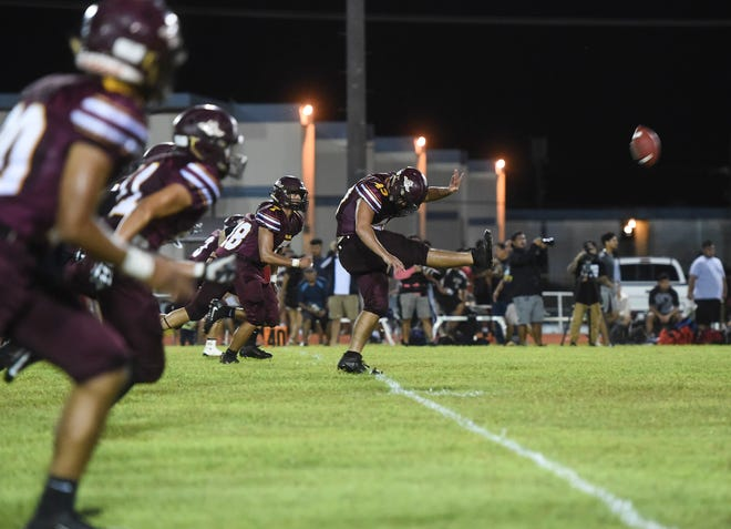 In this Aug. 24 file photo, the Father Duenas Friars in the opener of the IIAAG High School Football season.