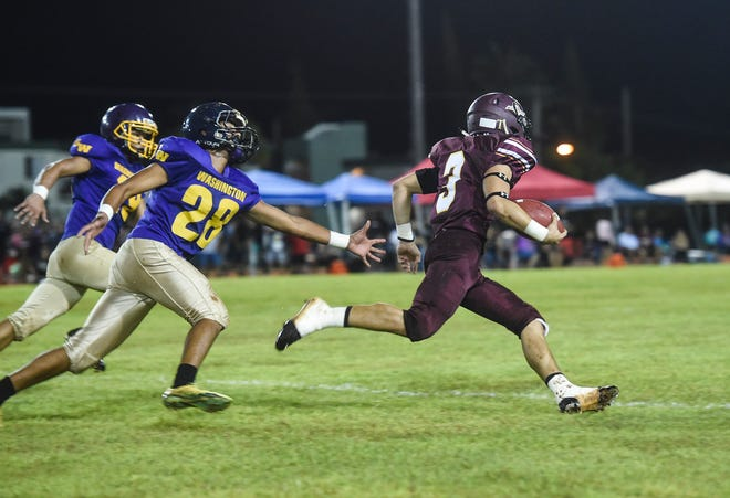 Father Duenas Friars running back Kein Artero goes for a few of his 228 yards he earned on the ground in FD's 26-19 win over the GW Geckos Aug. 24 at GW.