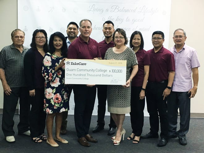 GCC and TakeCare officials at the TakeCare corporate office in Tamuning Aug. 27 for a $100,000 donation to GCC for health care programs, part of the company's qualifying certificate program. From left: Eloy Hara, GCC Board of Trustees treasurer; Carmen Santos, GCC finance vice president; Lorraine Okada, GCC Foundation board chair; Carlo Leon Guerrero, GCC Board of Trustees member; Jeff Larsen, TakeCare vice president; Mike Tsai, TakeCare IT director; Mary Okada, GCC president; Alicia Iseke, TakeCare Health Plan finance administrator; Arvin Lojo, TakeCare Health Plan administrator; and Ed Ilao, GCC Foundation board member.
