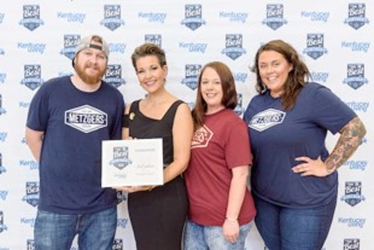 Zachary Overfield, Katie Beth Pritchett, and Moriah Hobgood accept Metzger's Tavern 3rd Place Hamburger award at the 2018 Best in Kentucky Awards. Overfield, Pritchett, and Hobgood are pictured with emcee Heather French Henry following Kentucky Living's awards show at the Kentucky State Fair on Thursday, Aug. 23, 2018 in Louisville, Ky., on the Gourmet Garden stage. (Photo by Brian Bohannon)