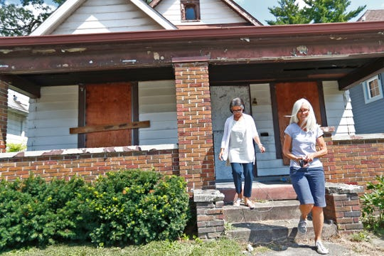 Celeste Burks, left, and Cindy Palmer, walk down the front steps, Thursday, Aug. 23, 2018, in front of what will be the Heart Change Ministries Covenant Community house for people in the neighborhood to meet for community activities.  This house was gutted and will be renovated for use.  Heart Change Ministries works to help young women, on the east side, to find stability for themselves and their families.  The nonprofit is a holistic mission trying to help families escape generational poverty.  There's an education piece called Mother's University, a work piece with making soaps, and Covenant Community which involves housing.