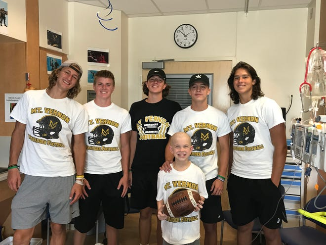 Mt. Vernon's football team is supporting 9-year-old Tyler Ralstin in his battle with leukemia.