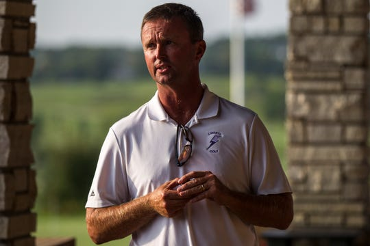 Liberty golf coach Sean McCarty announces results to players during a golf meet on Thursday, Aug. 23, 2018, at Brown Deer Golf Course in Coralville, Iowa.